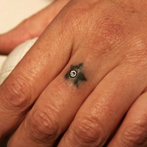 dermal anchor skindiver finger