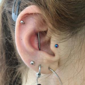 vertical industrial tragus helix lobe piercing