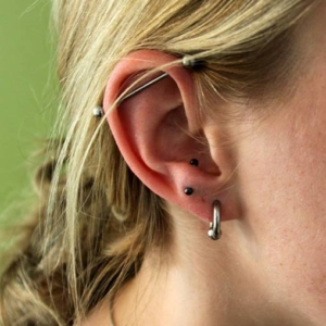 industrial anti tragus lobe piercing