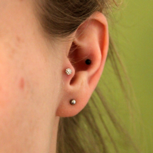 tragus lobe conch piercing
